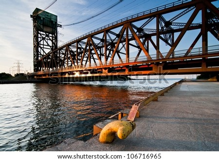 Lift bridge over canal in sunset color on lake ontario - stock photo
