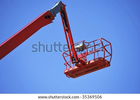 lift platform and basket to work in high places with security - stock photo