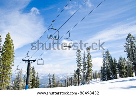 Lift to the top of the mountain at ski resort - stock photo