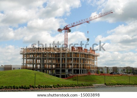 Lifting crane on the new building in apartment construction - stock photo
