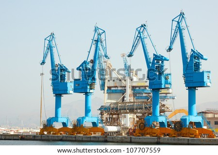 lifting cranes in port, Palermo, Italy - stock photo
