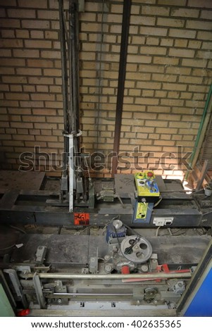Lifting mechanisms on the roof of a passenger elevator in an apartment house mine - stock photo