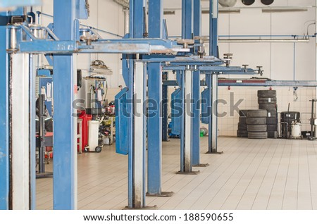 Lifts for cars in service center. - stock photo