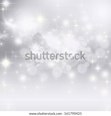 Light abstract Christmas background with holiday lights and white snowflakes
