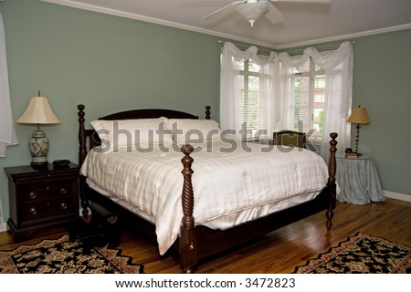 light and airy bedroom with antique furnishings - stock photo