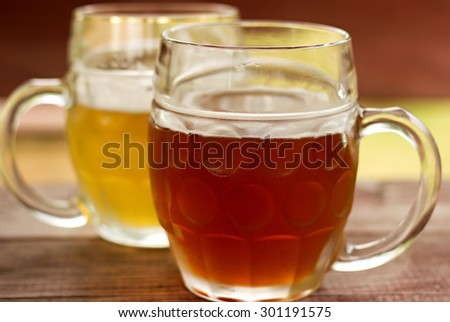 light and dark beer on the table - stock photo