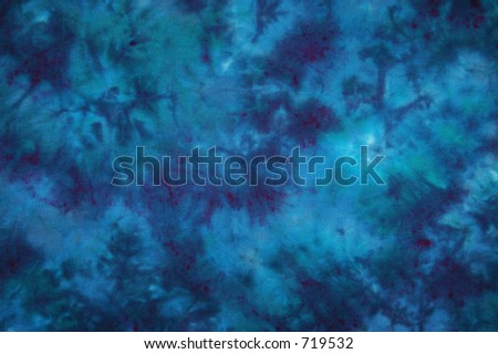 Light and dark blue tie dyed fabric - stock photo