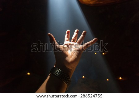 Light and powerful hand of hope. - stock photo