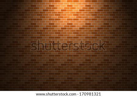 Light and shade on orange brick wall - stock photo