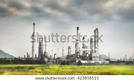 Light and Shadow of Oil refinery among grass at the early morning with cloudy. Tone Adjust