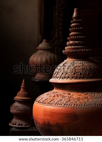 Light and shadow of Thai Earthenware, selective focus - stock photo