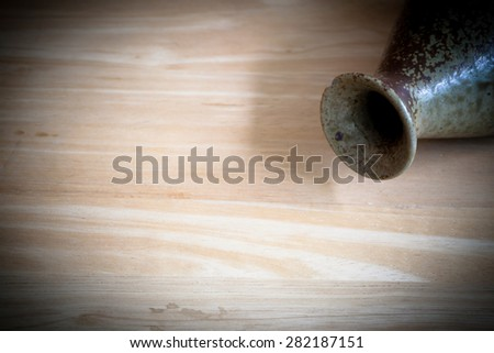 Light and shadow surfaces, ceramic vases background blurring.