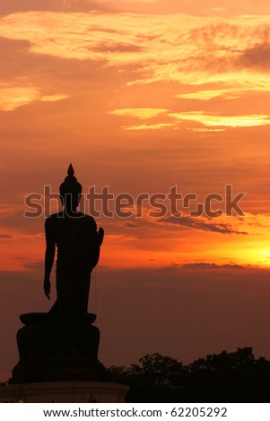Light and silhouette of Buddha statue, Thailand