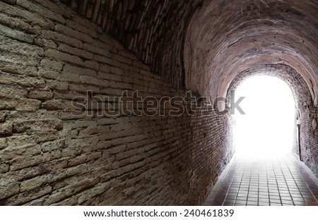 Light at the end of ancient tunnel, concept for hope or freedom - stock photo
