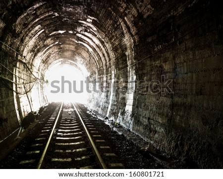 Light at the end of railroad tunnel. Khuntan tunnel ,Thailand. - stock photo