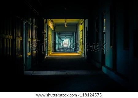 Light at the end of the hallway in dark colors - stock photo