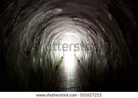 Light at the end of the  old tunnel - stock photo