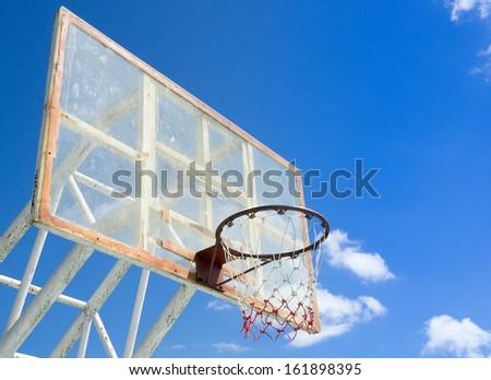 Light basketball hoop and net against blue sky - stock photo