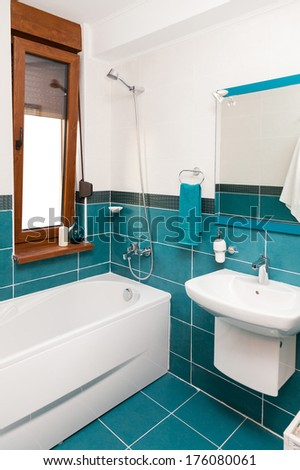 Light bathtub in a bathroom with window. - stock photo