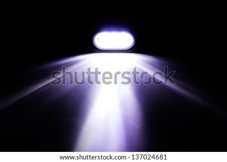 Light Beam from Electric Pocket Flashlight - stock photo