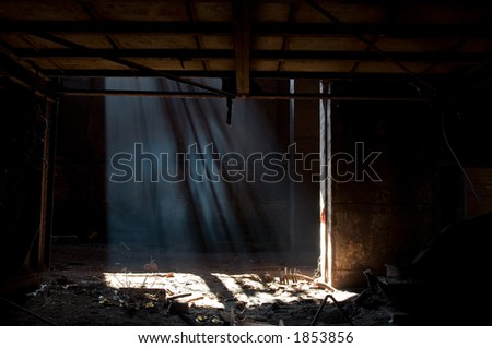 Light beams inside abandoned iron factory