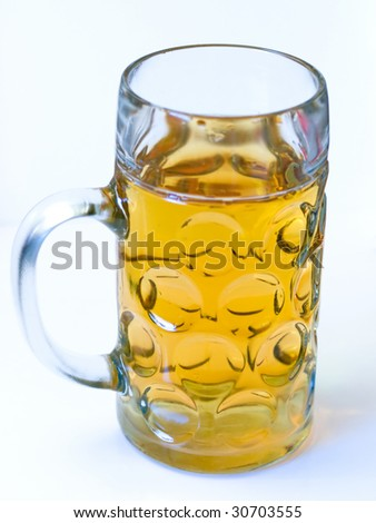Light beer in a big beer glass without foam isolated on a white background - stock photo