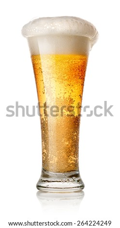 Light beer in a glass isolated on white