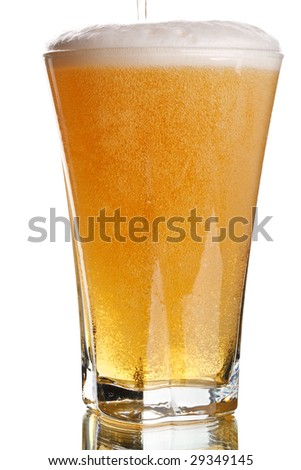 Light beer in a glass on a white background