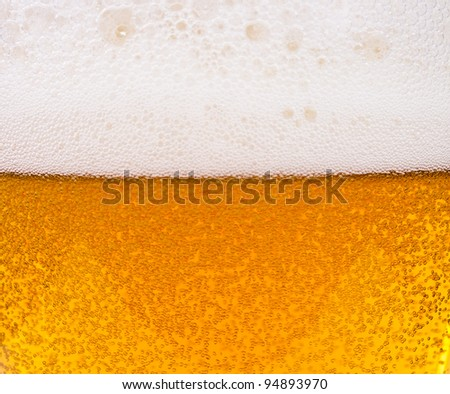 Light beer. Photo pour beer into a glass - stock photo