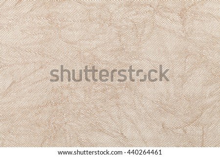 light beige wavy background from a textile material. Fabric with natural texture closeup. Upholstery fabric pleated.