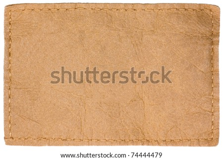 Light Blank Natural Leather Jeans Tag Label, Isolated Closeup, Rustic Background - stock photo