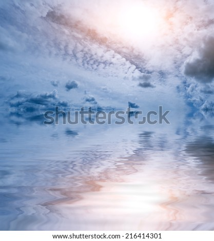 Light blue and pink abstract sky and ocean background: bright  sun and clouds pattern reflected in wavy water surface. Can be used as a wallpaper.