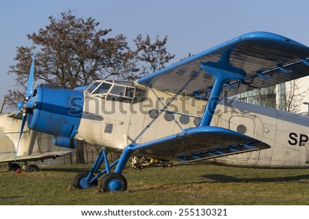 Light blue and white biplane aircraft in museum - stock photo