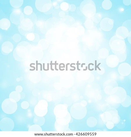 light blue blur abstract background / bokeh background / christmas blurred background / Abstract holiday background / beautiful shiny Christmas lights / abstract background with a white Light silver