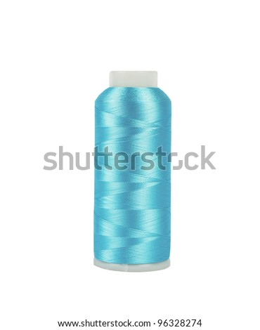 light blue bobbin of professional threads for machine embroidery - stock photo
