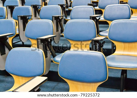 Light blue chair in the conference room - stock photo