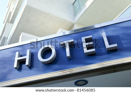 Light blue facade of modern new hotel - stock photo