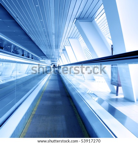 light blue fast moving escalator by motion - stock photo