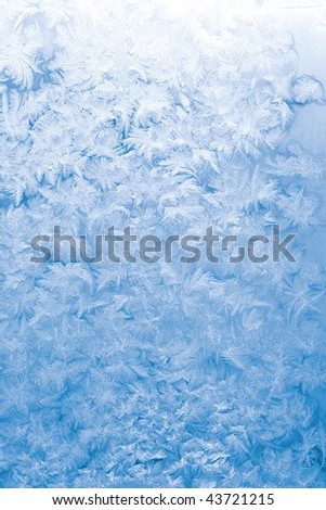 Light blue frozen window glass background