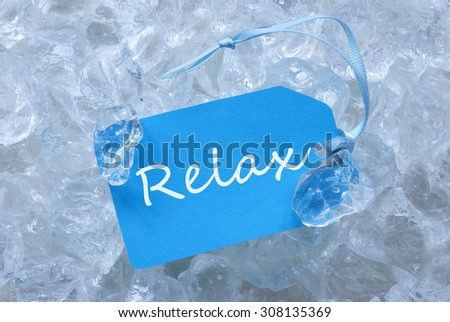 Light Blue Label With Blue Ribbon On White Transparent Curshed Ice Cubes As Background. English Text Relax For Cool Greetings.Close Up Or Macro View.  - stock photo