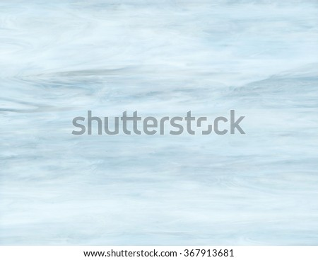 Light blue opalescent stained glass - stock photo