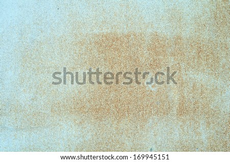 Light blue painted metal sheet with slight rust formation, a backdrop for multiple use - stock photo