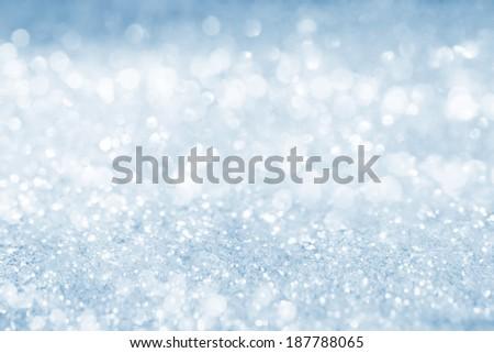 Light blue/silver glitter bokeh background texture - stock photo