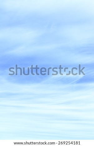 Light blue sky with cirrus clouds, may be used as background - stock photo