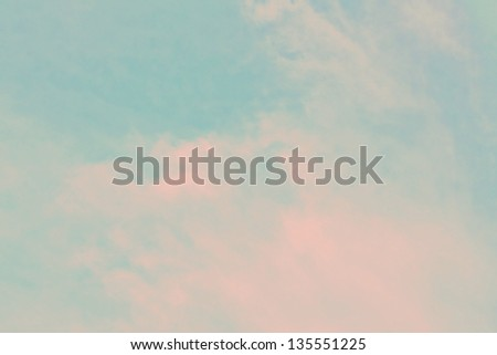 Light blue sky with pink clouds - stock photo