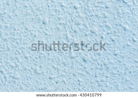 Light blue stucco wall texture background - stock photo