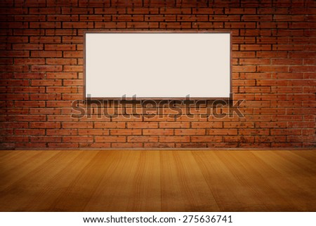 light box or white board on brick grunge wall and wood floor in room background - stock photo