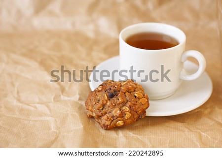 light breakfast: a cup of tea and diet oatmeal cookies horizontally