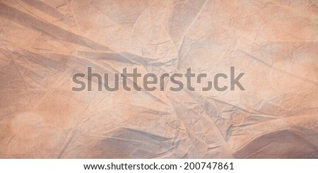 light brown background layout, tan or beige center with darker brown border and vintage grunge background texture, country western or old distressed and worn brown paper bag style image for brochures  - stock photo