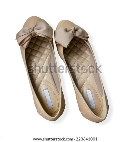 Light brown gloss summer and autumn flat shoes isolated on white